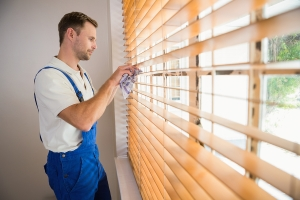 Man Cleaning Blinds